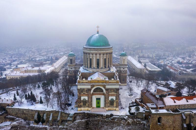 Esztergom, Hungary - Aerial view of the beautiful snowy Basilica of Esztergom. On a foggy winter morning stock images