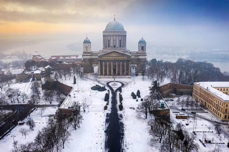 Esztergom, Hungary - Aerial view of the beautiful snowy Basilica of Esztergom on a foggy morning. Esztergom, Hungary - Aerial view of the beautiful snowy royalty free stock photos