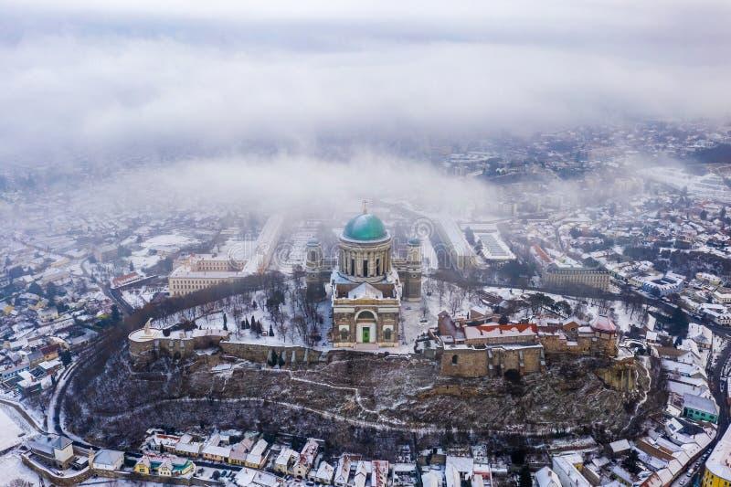 Esztergom, Hungary - Aerial view of the beautiful snowy Basilica of Esztergom on a foggy winter. Morning stock photos