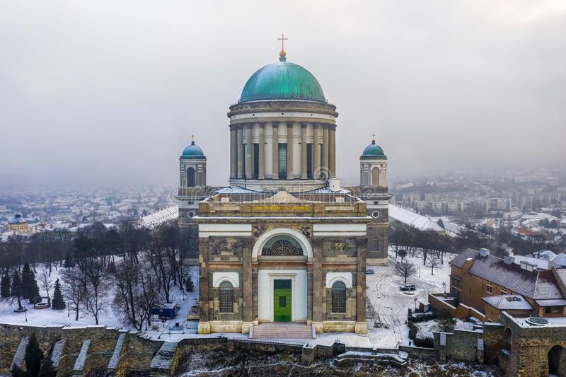 Esztergom, Hungary - Aerial view of the beautiful snowy Basilica of Esztergom on a winter morning. Esztergom, Hungary - Aerial view of the beautiful snowy royalty free stock images