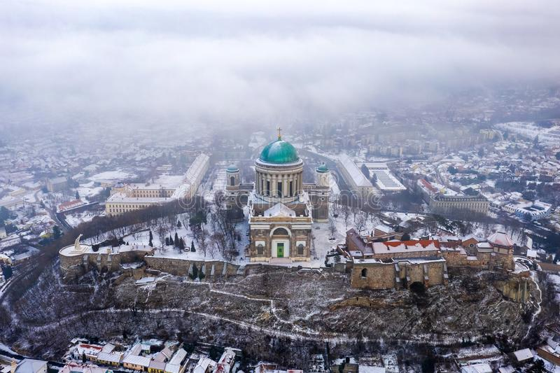 Esztergom, Hungary - Aerial view of the beautiful snowy Basilica of Esztergom on a foggy morning. Esztergom, Hungary - Aerial view of the beautiful snowy royalty free stock image