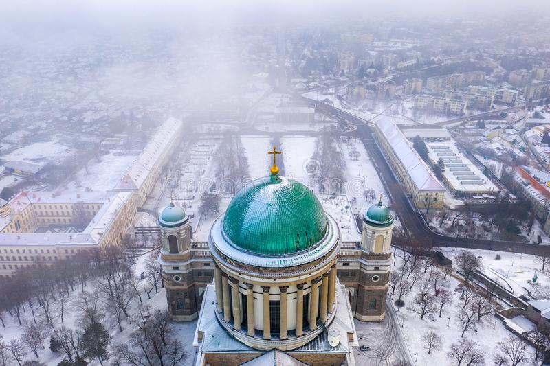 Esztergom, Hungary - Aerial view of the dome of the beautiful snowy Basilica of Esztergom on a foggy winter. Morning stock images
