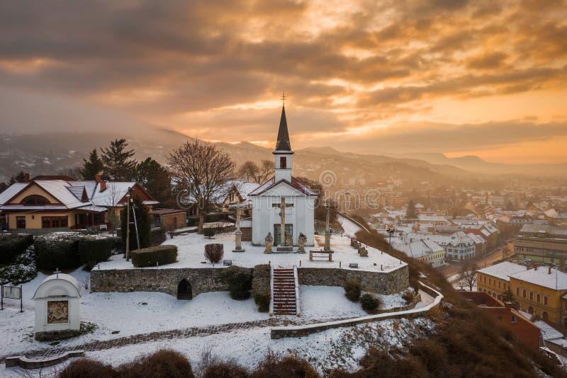 Esztergom, Hungary - Amazing golden sunrise at the Sorrowful Virgin Chapel on a misty winter. Morning stock photography