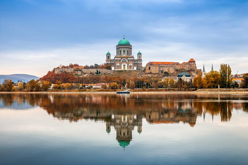 Esztergom, Hungary - Beautiful autumn morning with the Basilica of the Blessed Virgin Mary at Esztergom by the River Danube. Autumn colors and reflections of stock image