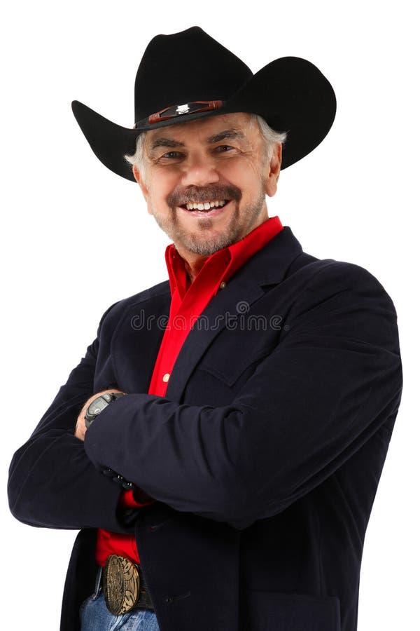 Età moderna anziana 75 del cowboy di giorno fotografia stock