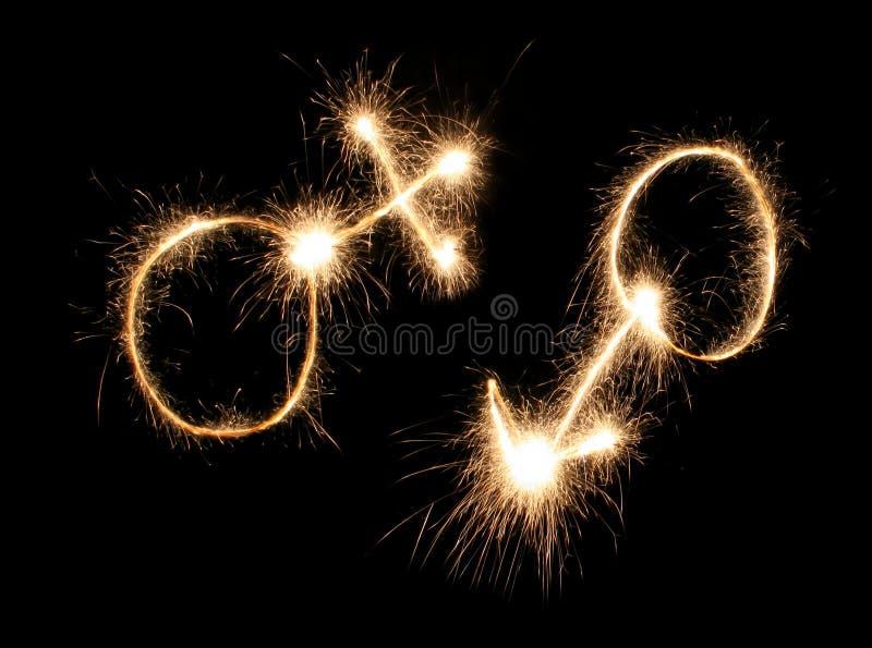 Et femelles sparkler dessiné par symboles mâles image stock