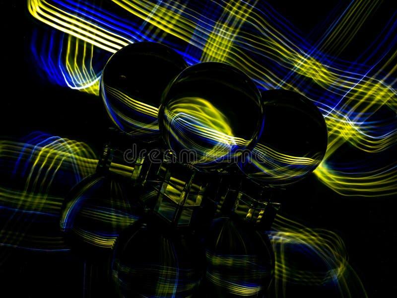 Or et modèle bleu de plaid à l'arrière-plan et au ZThrough reflété le Lensballs photos libres de droits