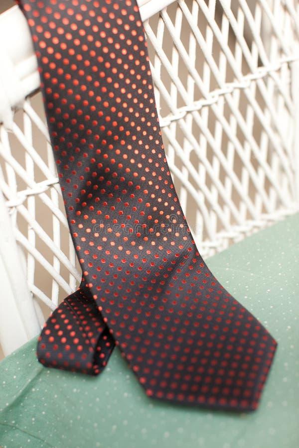 Et noire lien pointillé par polka orange photo stock