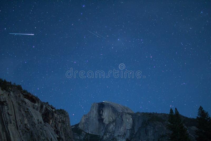 Eta Aquariids fireball and twin meteors over Half Dome. California, Yosemite National Park, Taken 05/2014 royalty free stock photography