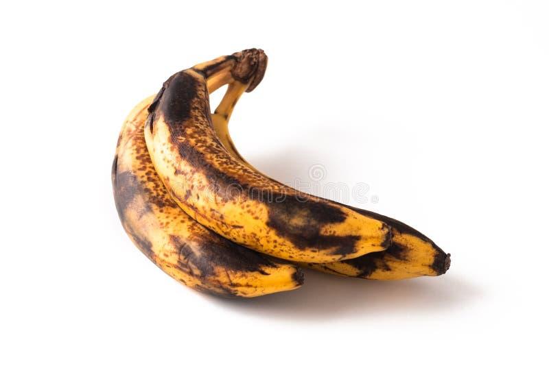 Etapa demasiado madura del concepto de la comida de plátanos en el fondo blanco fotos de archivo