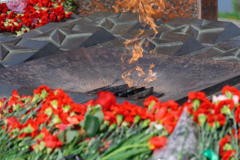 Eternal flame and flowers in memory of the fallen Russian soldiers of World War. II royalty free stock photos