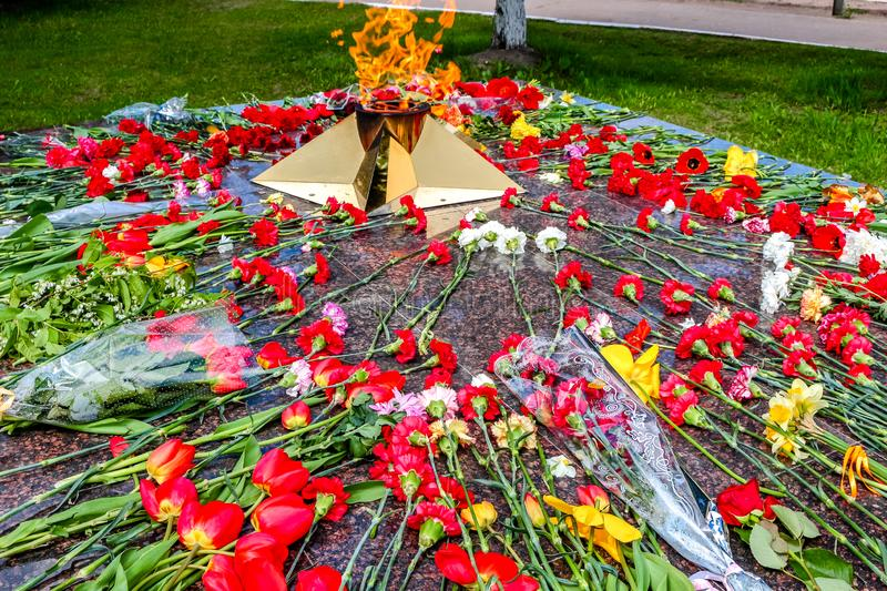 Eternal flame with flowers in memory of the victims of the Great Patriotic War 1941-1945. In Malojaroslavets, Russian stock photos