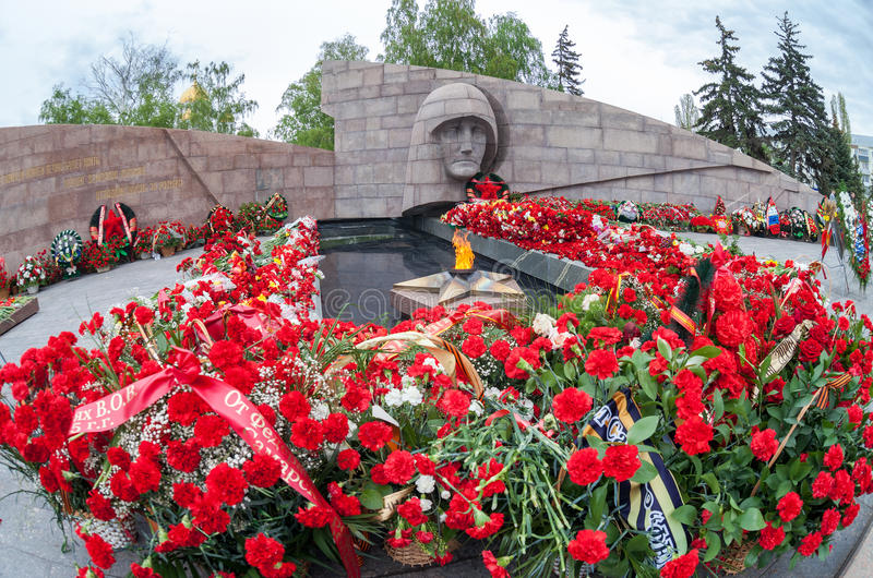 Eternal flame and flowers in memory of the Victory in the Great. SAMARA, RUSSIA - MAY 10, 2015: Eternal flame and flowers in memory of the Victory in the Great stock photo
