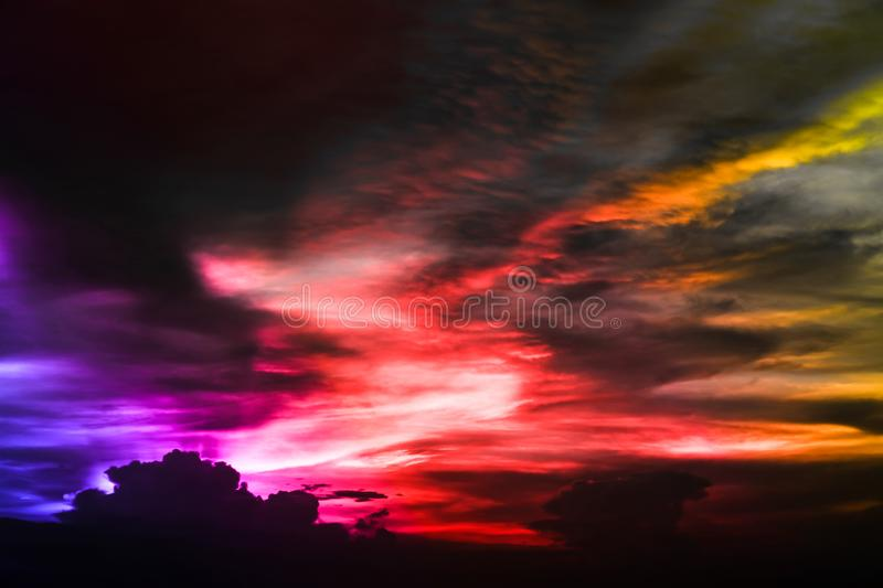 Eternal flame rainbow cloud and evening sky and ray light of sun. Eternal flame rainbow cloud and evening sky and ray of last light of sunset royalty free stock photography