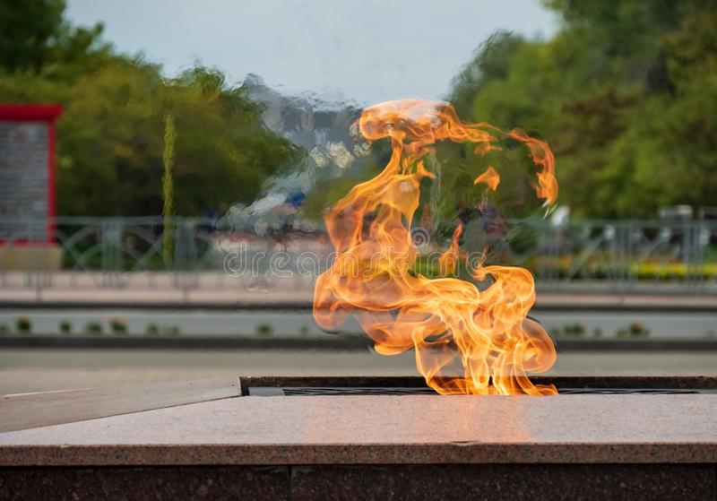 Fire flame symbol memory event monument monument town city street background traffic motor transport flames heat temperature tempe stock image