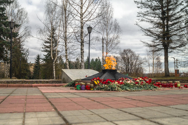 The Eternal Flame at the tomb of the Unknown soldier. Rzhev city, Tver region. This memorial is located at the foot of the obelisk to the liberators of the city royalty free stock image
