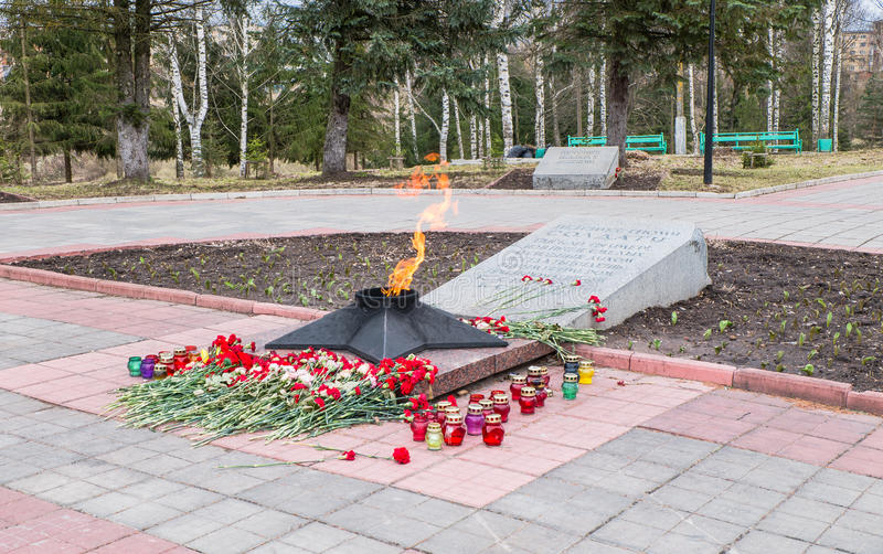 The Eternal Flame at the tomb of the Unknown soldier. Rzhev city, Tver region. This memorial is located at the foot of the obelisk to the liberators of the city royalty free stock photography