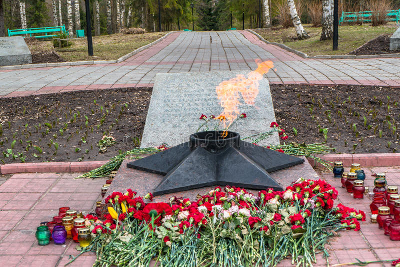 The Eternal Flame at the tomb of the Unknown soldier. Rzhev city, Tver region. This memorial is located at the foot of the obelisk to the liberators of the city stock photography