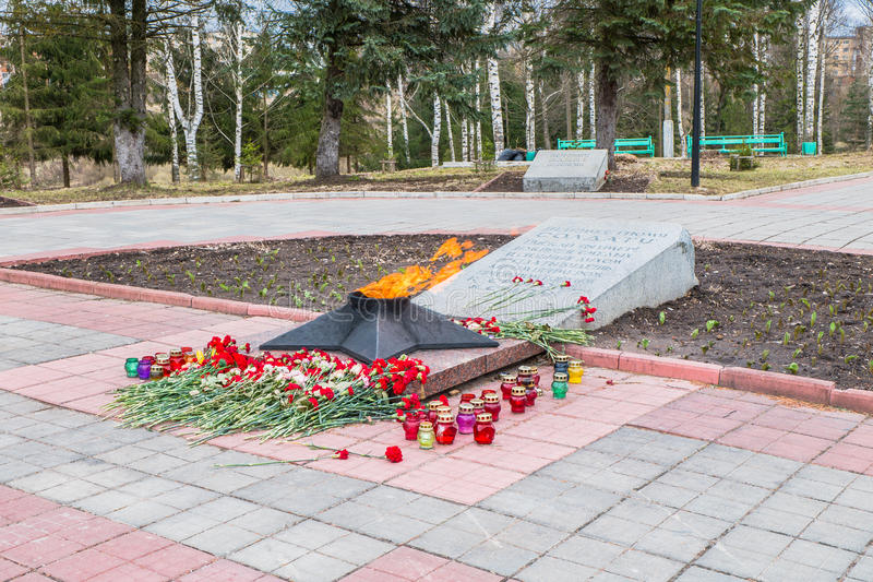 The Eternal Flame at the tomb of the Unknown soldier. Rzhev city, Tver region. This memorial is located at the foot of the obelisk to the liberators of the city stock image