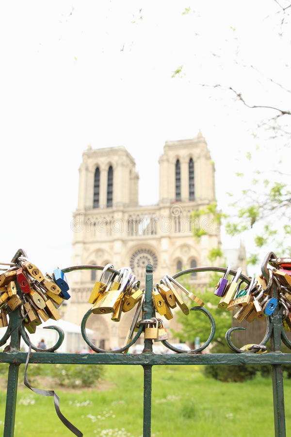Eternal Love. Padlocks locked to the fence in front of Notre Dame, Paris. Lovers believe and convince that this is an action of immortalizing their love stock image