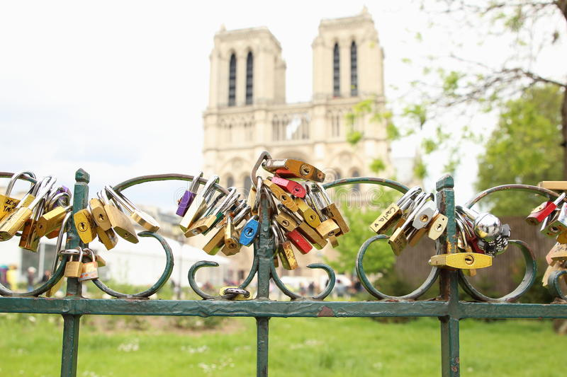 Eternal Love. Padlocks locked to the fence in front of Notre Dame, Paris. Lovers believe and convince that this is an action of immortalizing their love royalty free stock photo