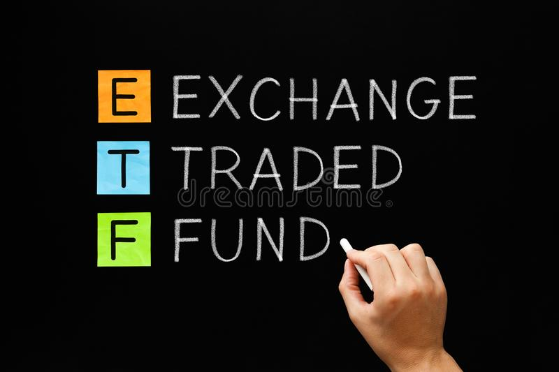 ETF - Exchange Traded Fund Concept. Hand writing ETF - Exchange Traded Fund with white chalk on blackboard stock photo