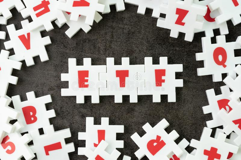ETF, Exchange Traded Fund concept, white puzzle jigsaw with alphabet ETF at the center, a type of investment fund that is traded. On a stock exchange stock photography