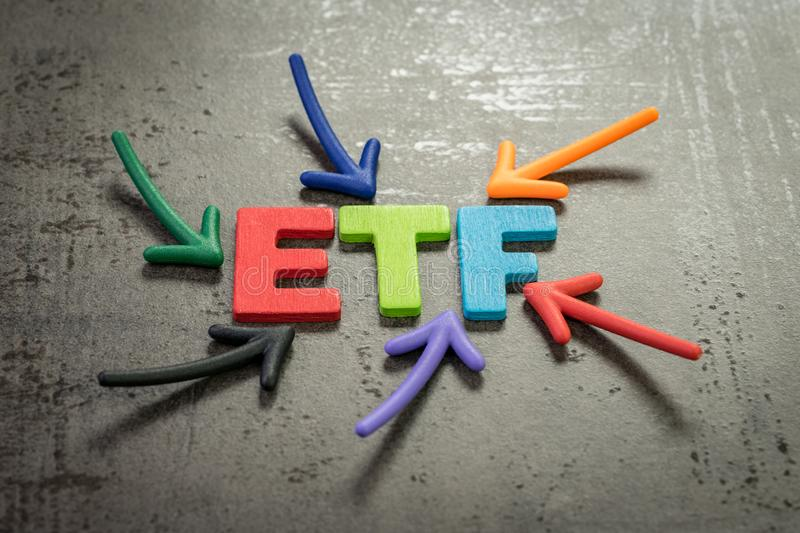 ETF, exchange-traded fund an investment fund traded on stock exchanges concept, multi color arrows pointing to the word ETF at the stock photo