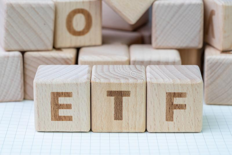 ETF, Exchange Traded Fund, realtime mutual index fund that can t. Rade in equity stock market, cube wooden block with alphabet building the word ETF on grid line stock photos