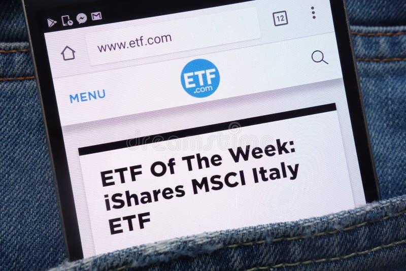 ETF website displayed on smartphone hidden in jeans pocket royalty free stock image
