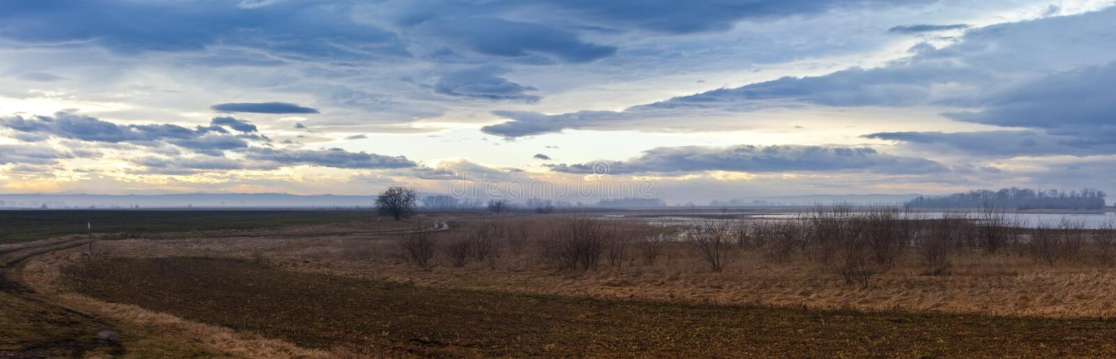 Ethereal landscape with moody sky above Nationalpa stock photos