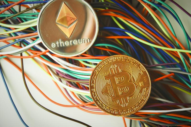 Ethereum and Bitcoin and wires royalty free stock photos
