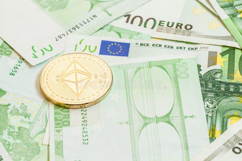 Ethereum coin on euro money stock photos