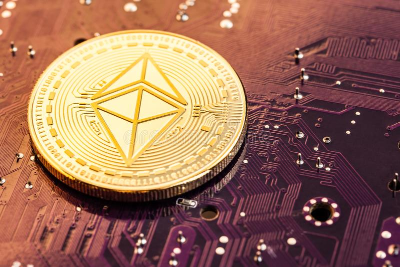 Ethereum coin on motherboard royalty free stock photography