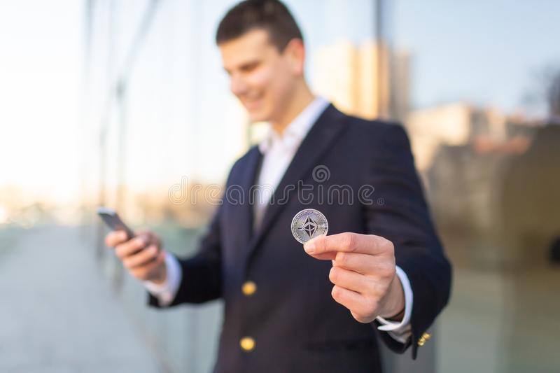 Businessman trader holding Ethereum cryptocurrency. royalty free stock image