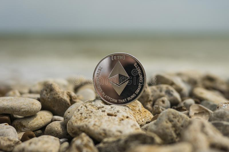 Ethereum Cryptocurrency. e-currency. sea stones stock photography