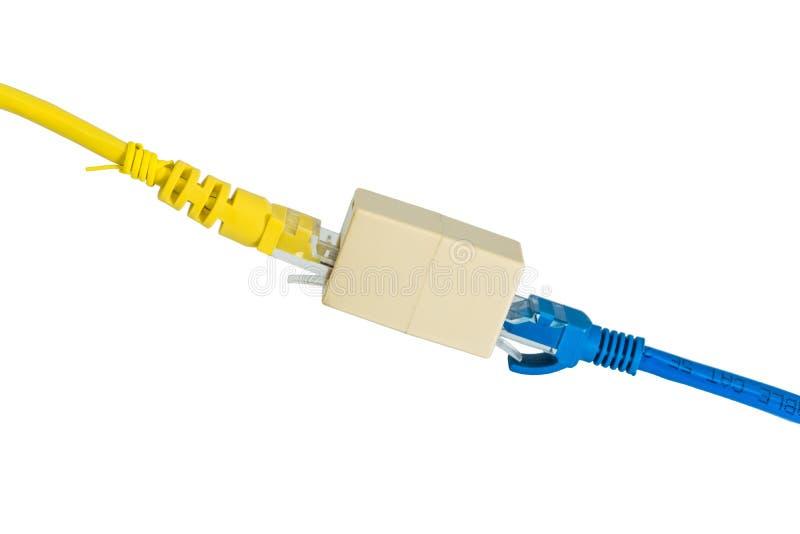 Ethernet azul y amarilla Cat5e telegrafía el suplemento o del cable del enchufe RJ45 foto de archivo libre de regalías