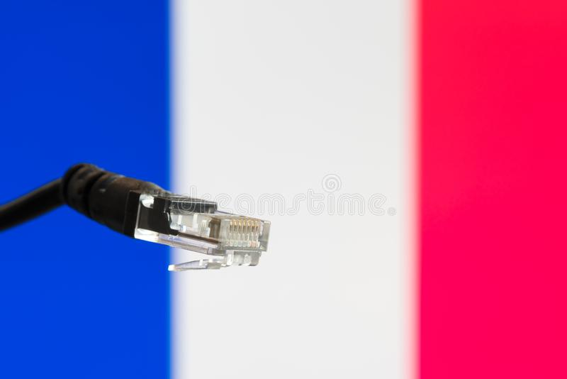 Ethernet cable with French flag in the background. Symbolizing internet in France stock photos