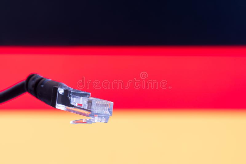 Ethernet cable with German flag in the background. Symbolizing internet in Germany royalty free stock photos