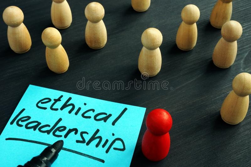 Ethical leadership. Wooden figures on a desk stock photo