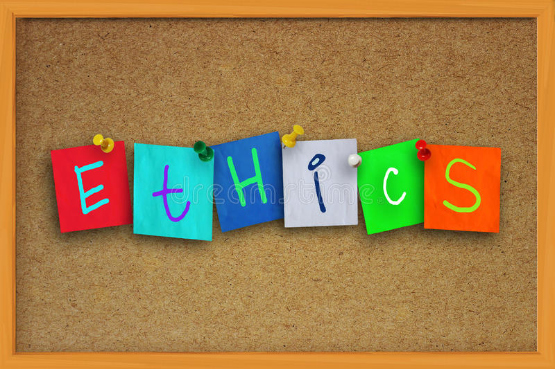 Ethics Concept. The word Ethics written on sticky colored paper over cork board royalty free stock photography