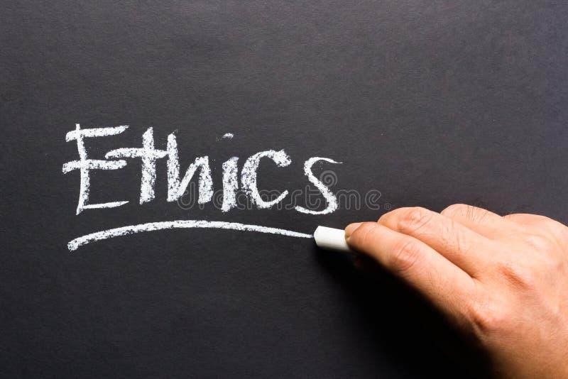 Ethics. Hand writing Ethics topic on chalkboard royalty free stock photos