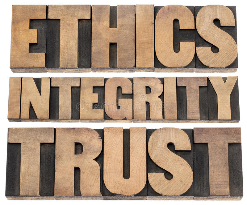 Ethics, integrity, trust. Word - a collage of isolated text in vintage letterpress wood type printing blocks stock image