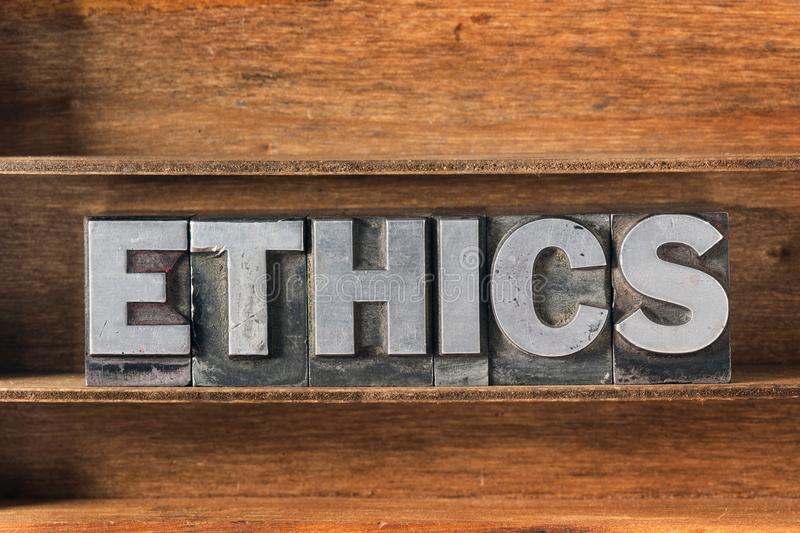 Ethics met tray. Ethics word made from metallic letterpress type on wooden tray stock photo
