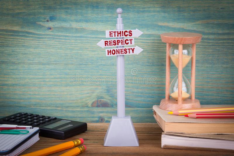 Ethics respect honesty, code of conduct. Signpost on wooden table royalty free stock images