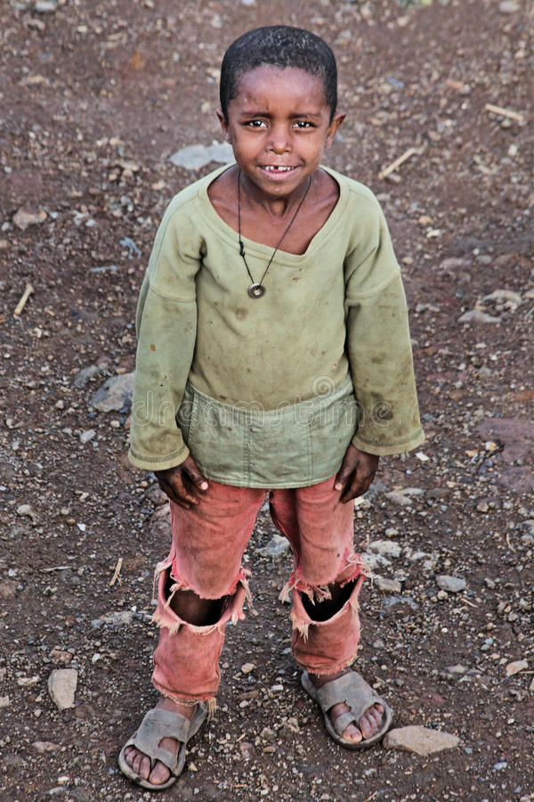 Ethiopia: Child and poverty. One of the cheerful but poor children living in the backstreets of Gonder, Ethiopia. Genuinely friendly and happy children living in royalty free stock image