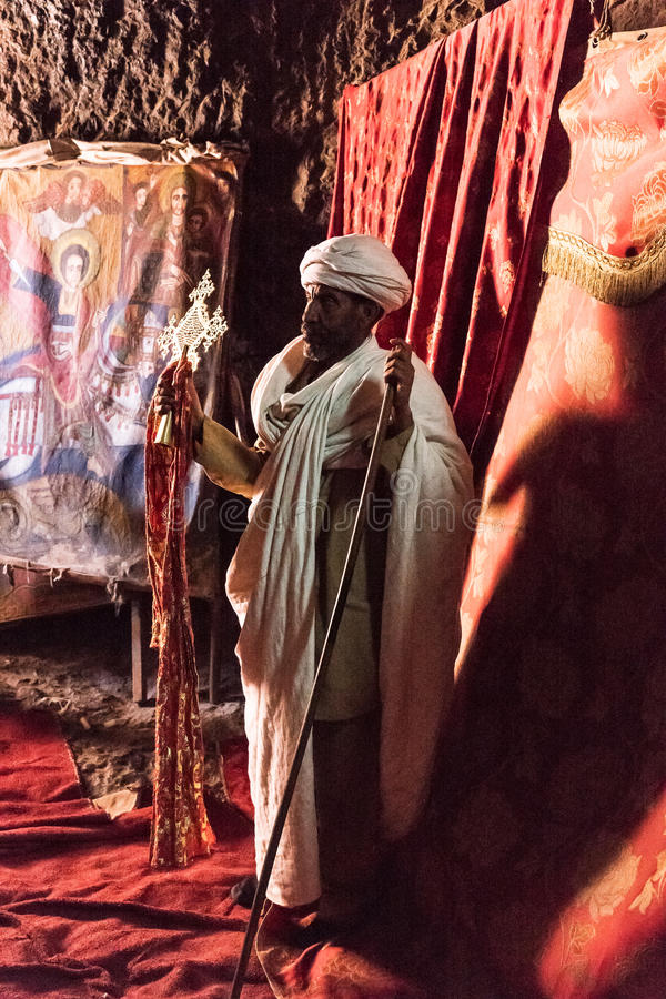 Ethiopia. Lalibela, Ethiopia - January 15 , 2016: A priest in the Bet Madane Alem Orthodox church stock photo