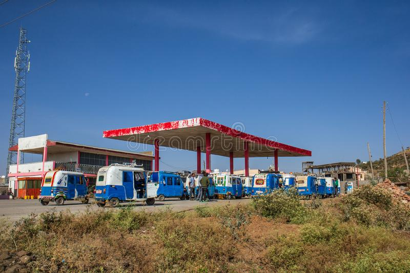 ETHIOPIA, MEKELLE, 01-12-2019. Bajaj waiting in line for fuel at a fuel station. Ethiopia often has fuel shortage which leads to long lines of cars and Bajajs royalty free stock photography