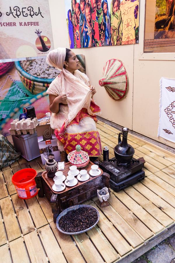 Ethiopian coffee ceremony. Kiel, Germany - June 27th 2019: Ethiopian coffee ceremony on the 125th Kiel Week stock photos