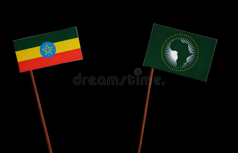 Ethiopian flag with African Union flag isolated on black. Background stock images
